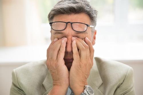 Man with eye irritation