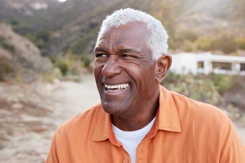 Senior man smiling outside