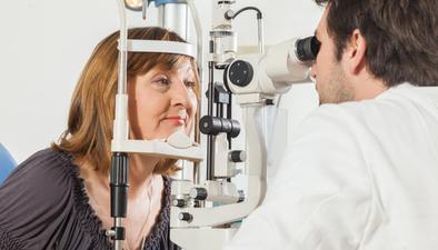 Middle age woman eye exam