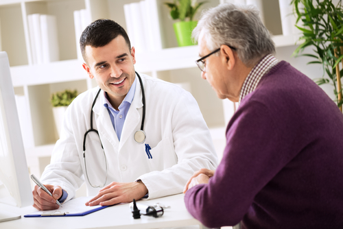 doctor and senior patient discussing medical history