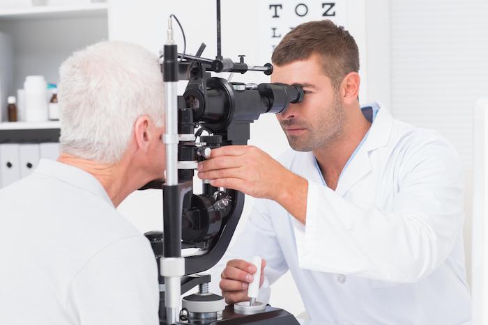 Senior man eye exam