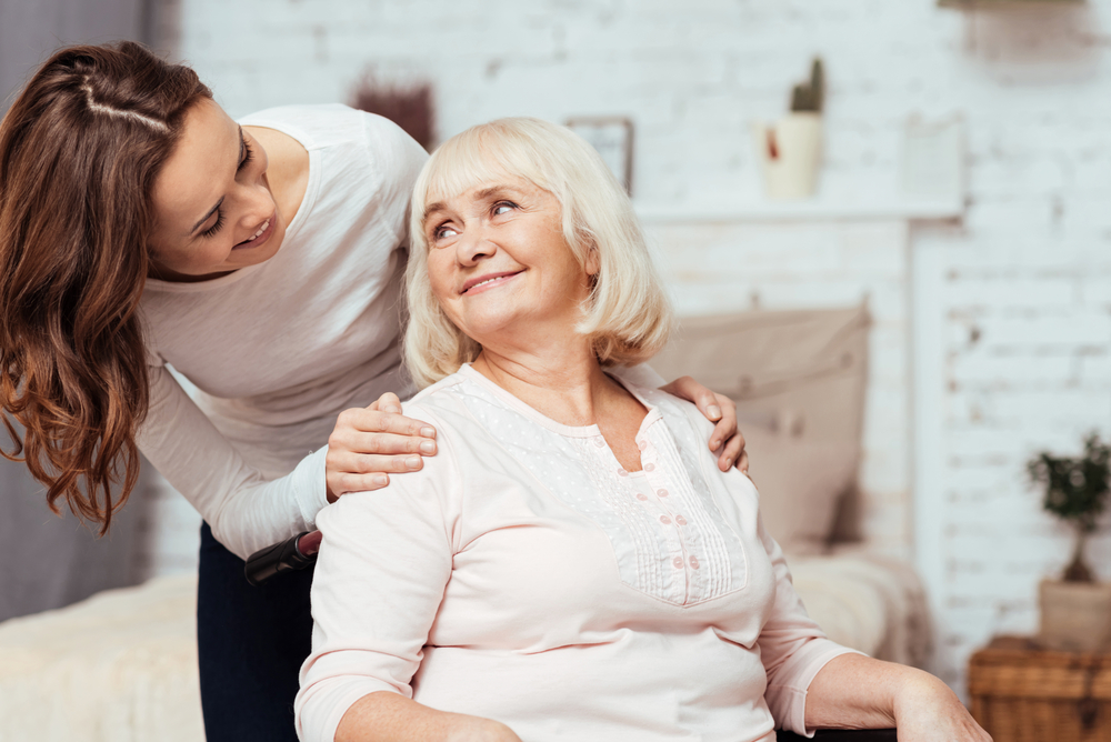helping a senior woman after surgery